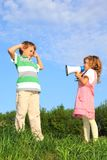 Children on nature and play with loudspeaker Royalty Free Stock Photos