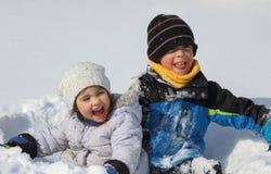 Children in nature during winter. Children having fun in nature during winter royalty free stock photo
