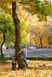 Children near autumn maple. Royalty Free Stock Photo