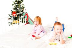 Children near a new-year tree Stock Photo