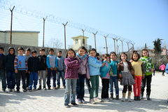 Children near the school rof refugees. Group of children waiting for next lessons in school for syrian refugees Stock Photo