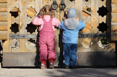 Children near the wooden gates Stock Image
