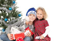 Children near Xmas tree Stock Image