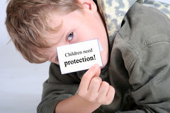 Children need protection. Young boy with a shield children need protection royalty free stock photos