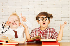 Children nerds. Two cute children nerds are perplexed and thinking Royalty Free Stock Photos