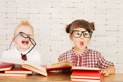 Children nerds. Two children nerds are perplexed and thinking Royalty Free Stock Photo