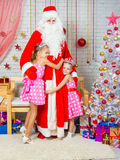 For children in the New Year's Eve Santa Claus came, they happily embrace it Stock Photography