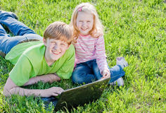 Children with notebook outdoor Royalty Free Stock Photo