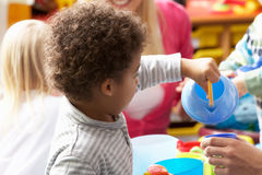 Children in nursery. Playing with toys Stock Photo