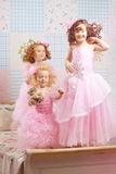Children in the nursery in pink dresses Royalty Free Stock Image