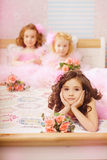 Children in the nursery in pink dresses Stock Photo