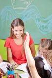 Children and nursery teacher royalty free stock photos
