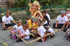 Children with devil doll, New Years festival,Bali Stock Photo
