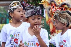 Children with devil doll, New Year  festival,Bali Royalty Free Stock Photos