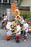 Children with devil doll, New Years festival,Bali Royalty Free Stock Photo