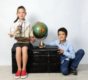 Children with old globe and ship Royalty Free Stock Images