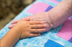 Children and old hands Royalty Free Stock Image