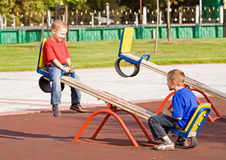 Free Children On A Seesaw Royalty Free Stock Image - 11005656
