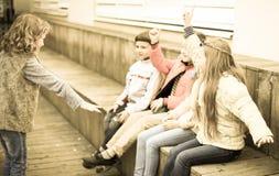 Children On Bench Playing Children`s Games