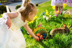 Children On Easter Egg Hunt With Bunny Royalty Free Stock Images