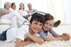 Children On Floor Listening To The Music In Livi Royalty Free Stock Images