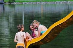 Children On Slide At Lake Royalty Free Stock Images
