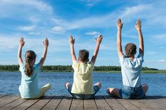 Free Children On The Lake Doing Yoga In Good Weather Royalty Free Stock Images - 152540729