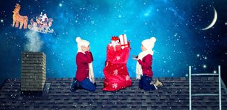 Merry Christmas and Happy Holidays!Children open a bag of gifts from Santa. Santa dropped a sack of presents to small children on stock images