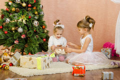 Children opening Christmas gifts Stock Photography