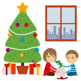 Children Opening Christmas Gifts Royalty Free Stock Photography