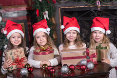 Children Opening Gifts. Royalty Free Stock Photo