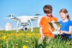 Children operating of flying drone at sunset Royalty Free Stock Photography