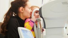Children ophthalmology - optometrist Checks Child`s Eye Royalty Free Stock Image