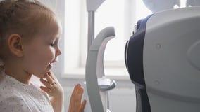 Children ophthalmology - optometrist Checks Child`s Eye
