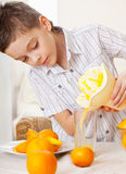 Children with oranges Stock Photo