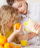 Children with oranges. Kids squeezed orange juice Stock Photography