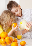 Children with oranges. Kids squeezed orange juice royalty free stock photography