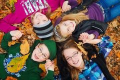 Children outdoor on autumn leaves Royalty Free Stock Photos