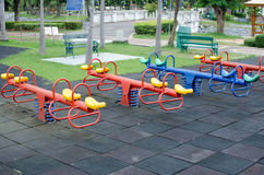 Children outdoor Playground fun. Totter in playground.fun and happy Stock Image