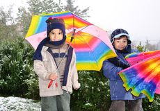Children outdoor, snowing on them Stock Images