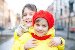 Children outdoors in early spring. Portrait of two children outdoors in early spring stock image