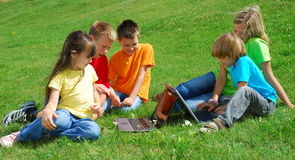 Children outdoors with laptops Royalty Free Stock Photography