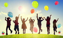 Children Outdoors Playing Balloons Togetherness Concept Stock Images