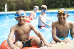 Children in outside swimming pool. A children group in outside swimming pool stock photo