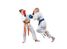 Children with overlays on hands are training punch in jump Royalty Free Stock Photo
