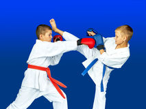 Children with overlays on his hands hit hitting karate Royalty Free Stock Image