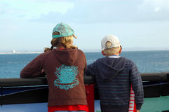 Kids. Two children by a safety rail at an scenic ocean overlook Stock Image