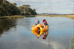 Children in paddle boat. Two young girls in a paddle boat at Gumbuyah Park in Tynong North, Victoria Australia; 8th July, 2015 Royalty Free Stock Images