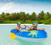 Children paddling rubber raft Stock Photography