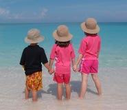 Children paddling in sea stock image